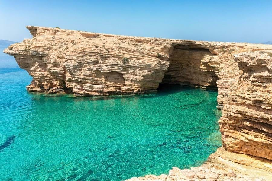 Stunning waters surround the Ksylobatis Caves on Ano Koufonisi in the southern Cyclades