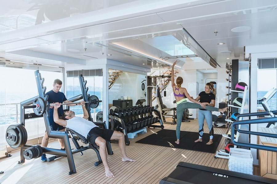 Workout with a personal trainer in an air-conditioned gym