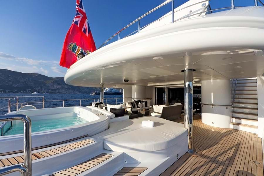 The pool, sunpads and lounge on the main deck aft