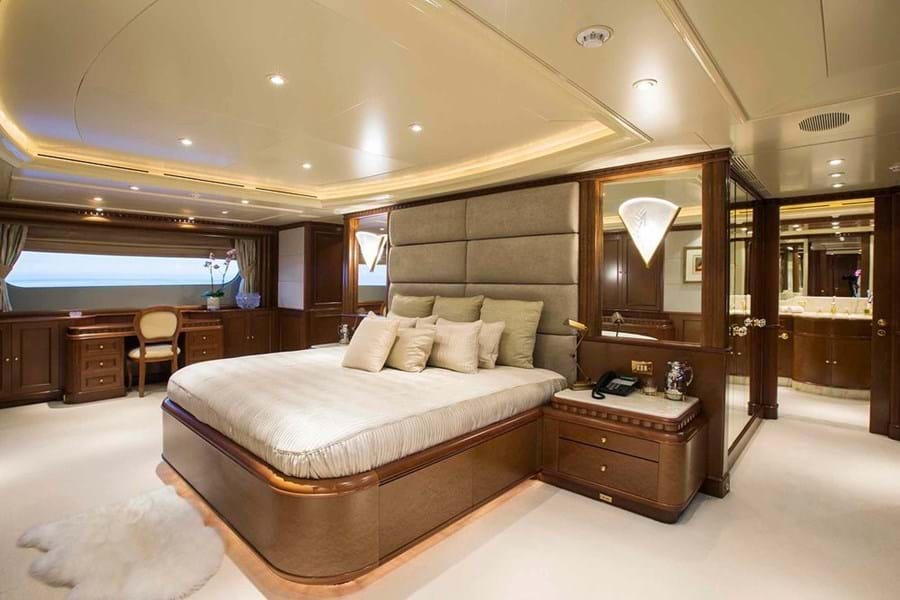 The berth in the full beam owner's suite faces aft, with the bathroom behind it