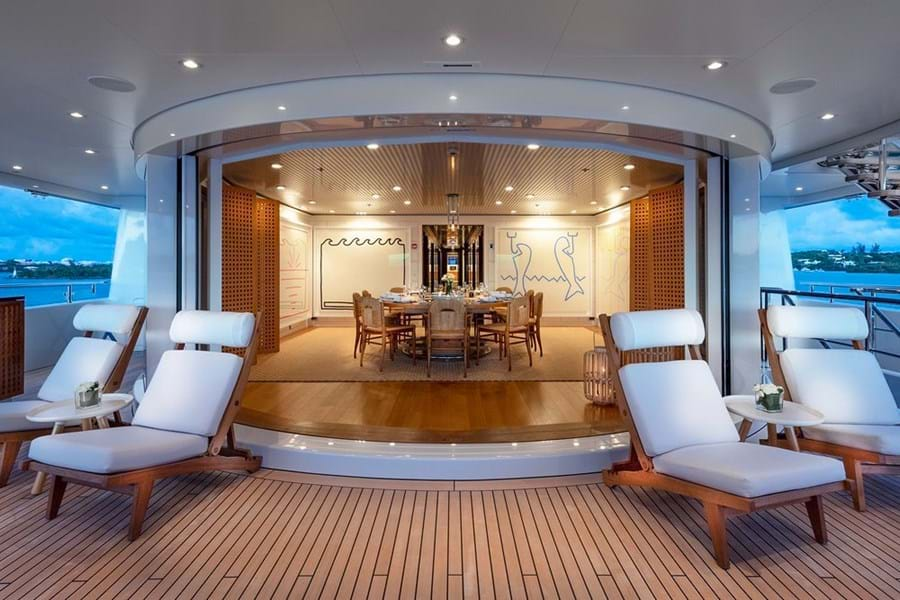 An indoor/outdoor circular dining room on the upper deck aft