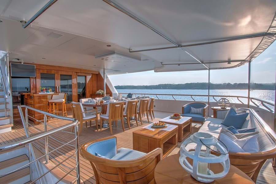 The bar, dining table and lounge area on the bridge deck aft