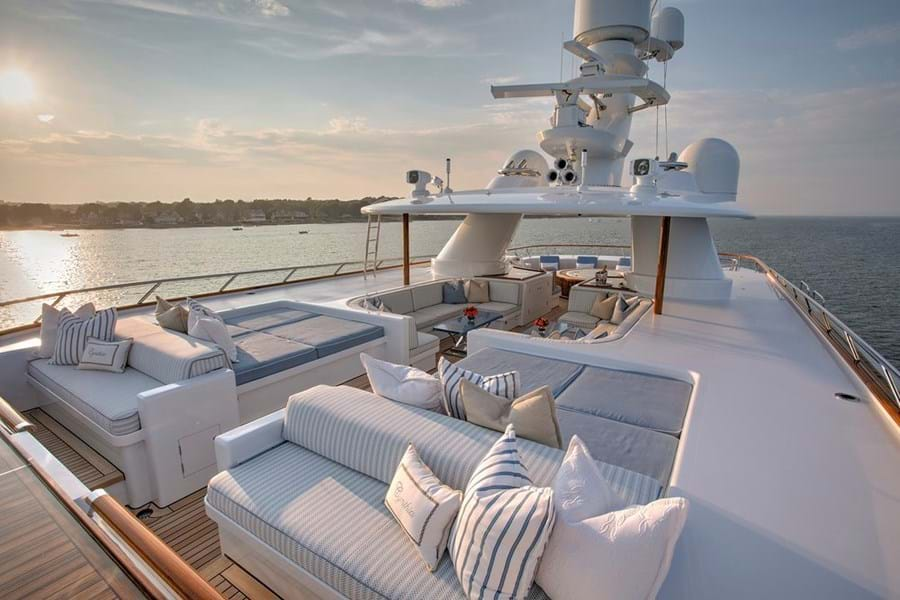 Sunpads and lounge seating forward on the sun deck, with the jacuzzi and sun loungers aft