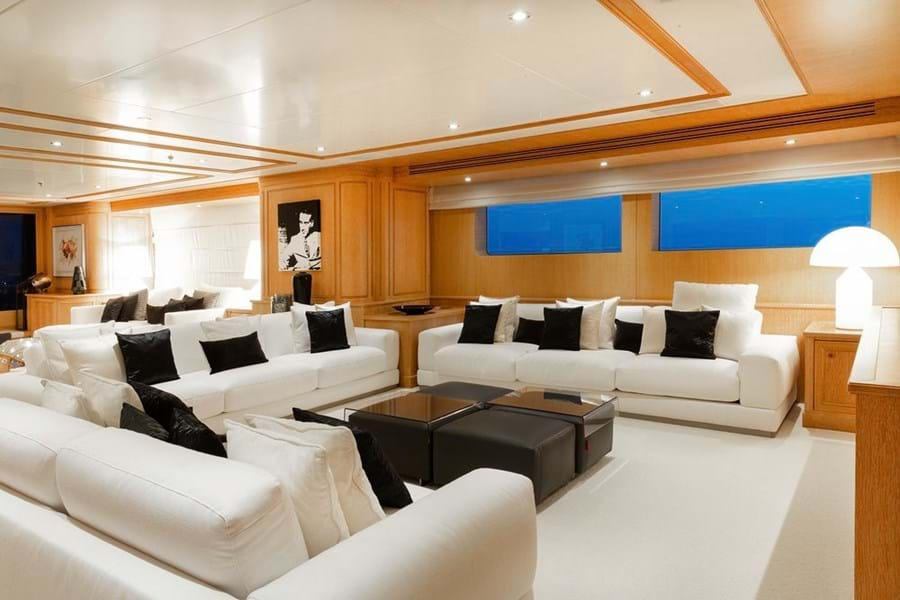 The main saloon is divided into two areas: a U-shaped seating area forward facing a 60in TV with surround sound...