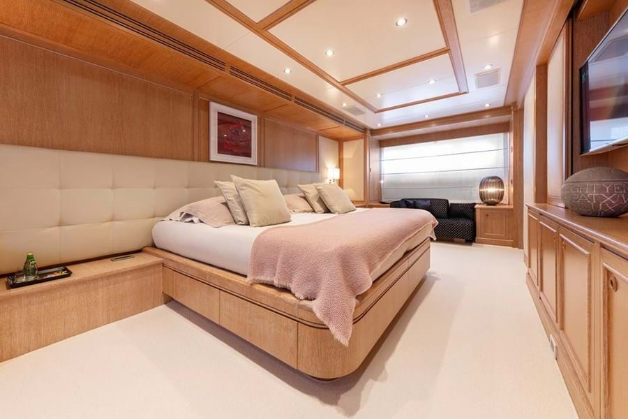 She accommodates 12 guests in five cabins. Forward on the main deck is the full beam owner's suite with seating either side, his and hers bathroom and walk in wardrobe