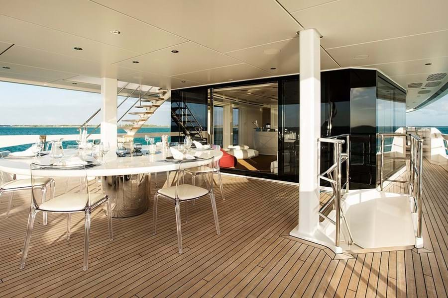 Open air dining on the upper deck aft where inside and out blend wonderfully