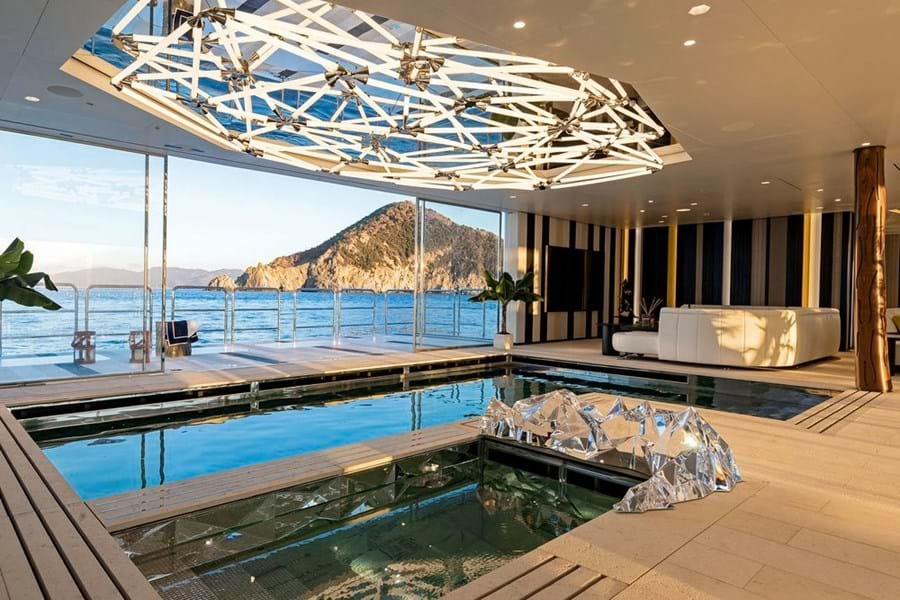 The pool and cold pool in the wellness spa and the 50sqm (538.2sqft) sea terrace to starboard. There is a second to port for the gym