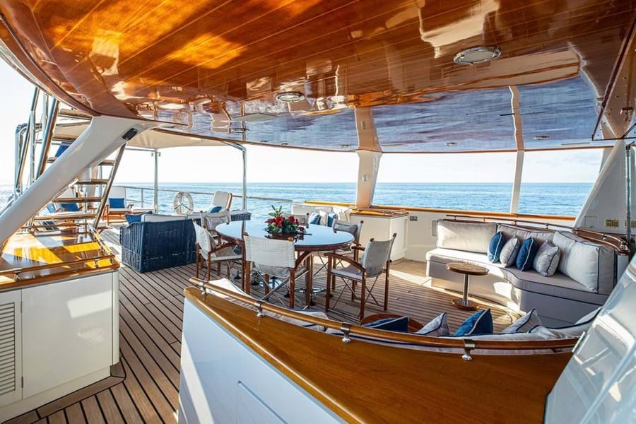 The lounge diner and lounge on the main deck aft, with sun lounging further aft