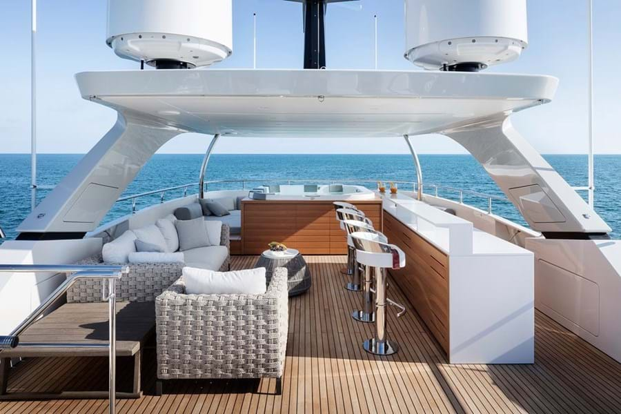 The sun deck with jacuzzi and sunpads forward, bar and lounge diner, with sun lounging deck aft