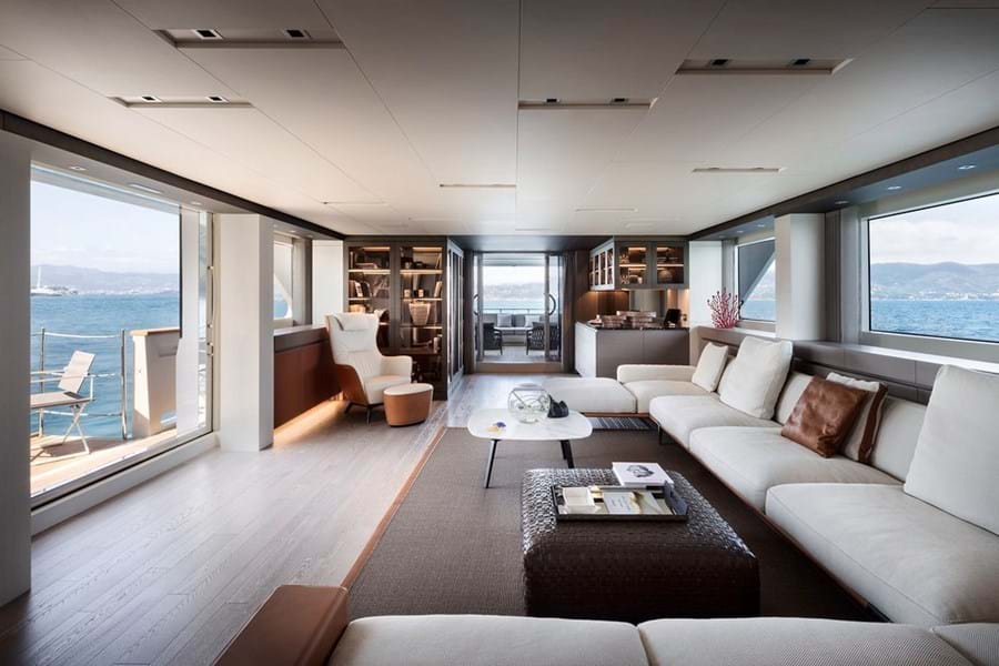 Looking aft in the main saloon with its folding balcony and open air lounge area aft
