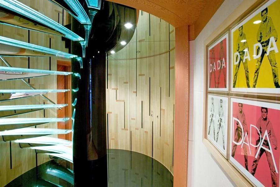 A feature spiral staircase links main deck guest accommodation to the upper deck