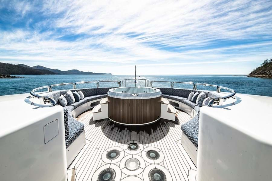 The foredeck jacuzzi and lounge with decklights in the foreground
