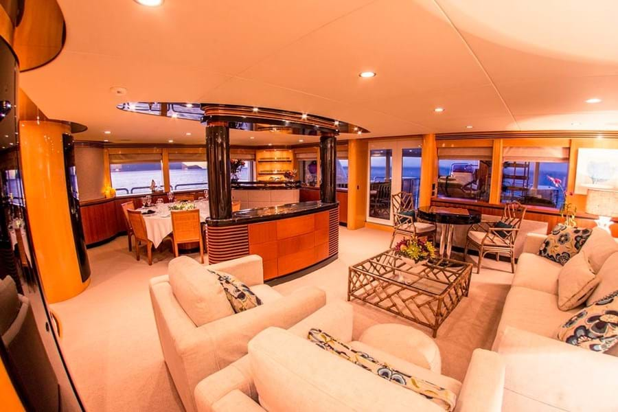 Looking starboard aft in the main saloon, the central console has a pop-up TV