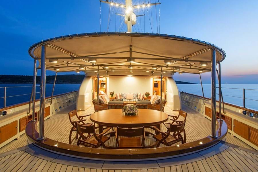 Open-air dining and lounging on the main deck aft