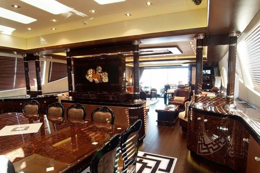 Looking aft in the main saloon, from the dining table with skylights across the saloon, bar onto the main deck aft