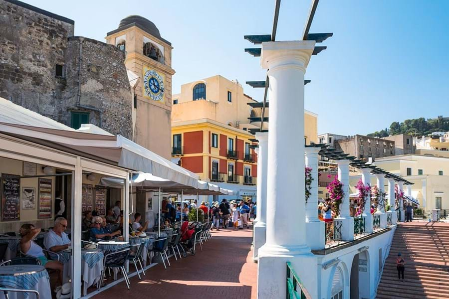 Cafes line the Piazzeta di Capri with views across the Bay of Naples