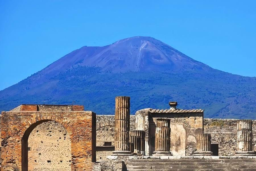 The ruins of the city lie in the shadow of Mount Etna
